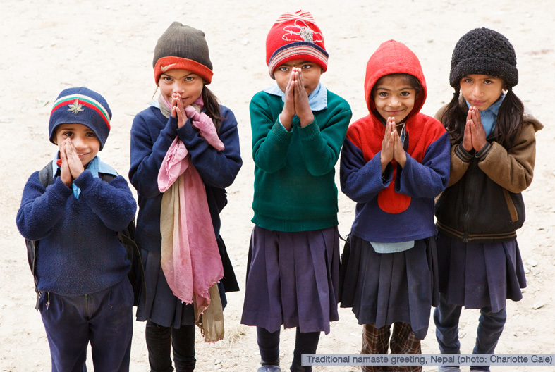 Children in Nepal giving Namaste greeting