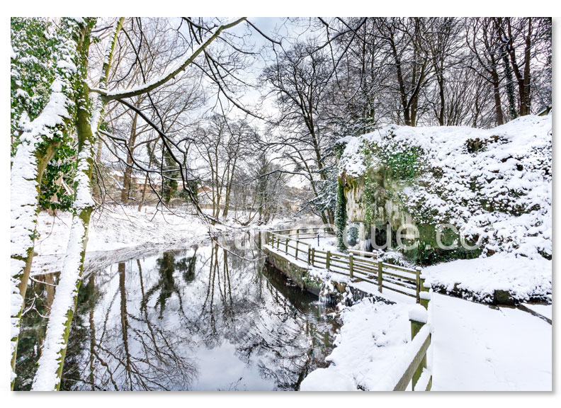 A Christmas card featuring a photo by Charlotte Gale of Mother Shiptons Cave & Dropping Well in the snow